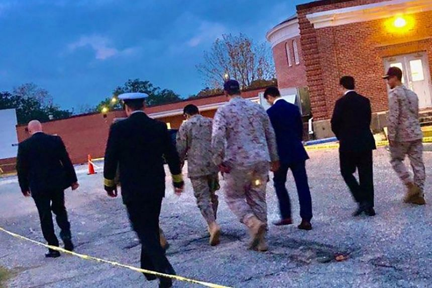 Saudi Arabia defence attache Fawaz Al Fawaz and his embassy staff and other officials arrive to meet Saudi students who remain restricted to the base.