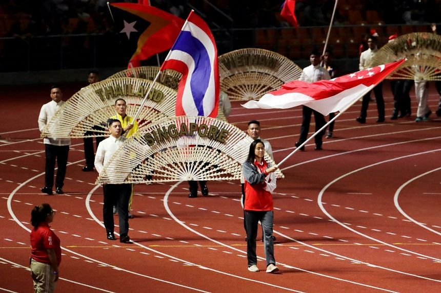A general view of the Singapore and Thailand flag bearers during the closing ceremony.