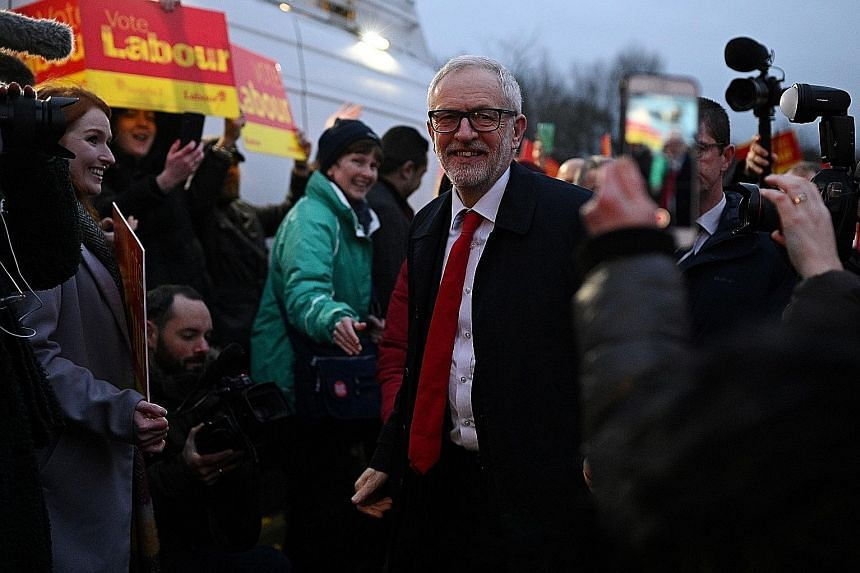 Left: Labour chief Jeremy Corbyn being greeted by supporters at a campaign event in Bolton yesterday. Politics lecturer Rosalind Shorrocks says the youth would likely vote for Labour over Conservatives. Above: Prime Minister and Conservative party le