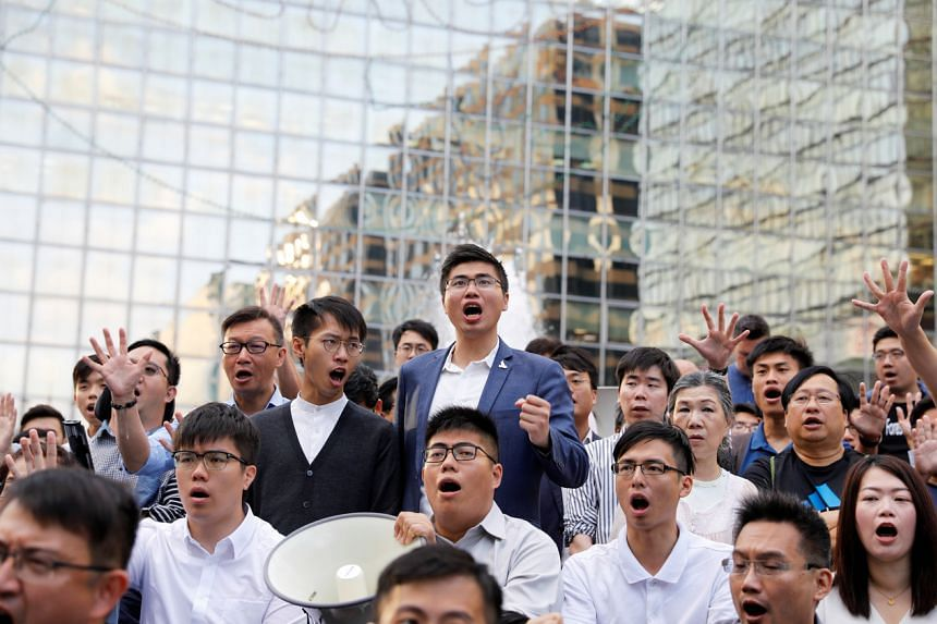 In a photo from Nov 25, 2019, pro-democracy candidates who won in district council local elections gather outside the Polytechnic University in Hong Kong.