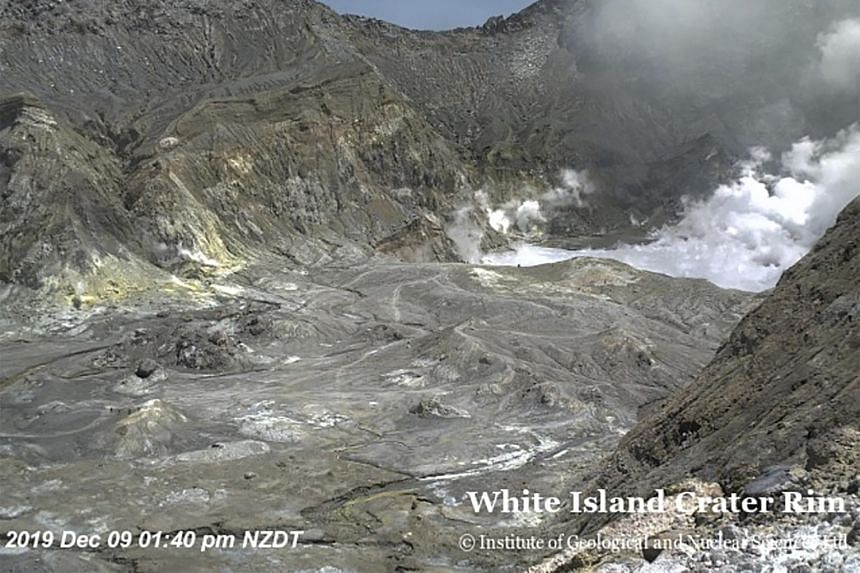 Tourists can be seen near the volcano's crater before its eruption on Dec 9, 2019, on White Island, New Zealand.