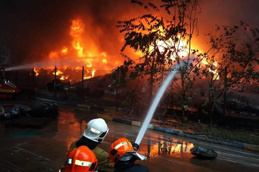 The SCDF deployed 34 emergency vehicles and 130 firefighters to No. 48 Tuas Crescent, where Unifine Star Petrochemical is located, on Dec 11, 2019.