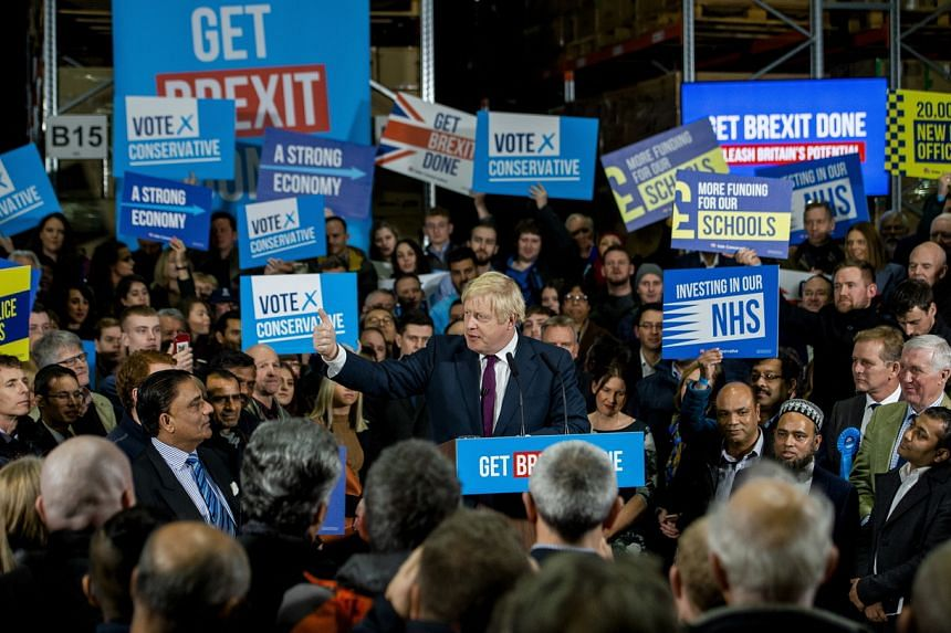 PM Boris Johnson delivers a speech during a visit to Globus Group, Manchester, Britain, on Dec 10, 2019.