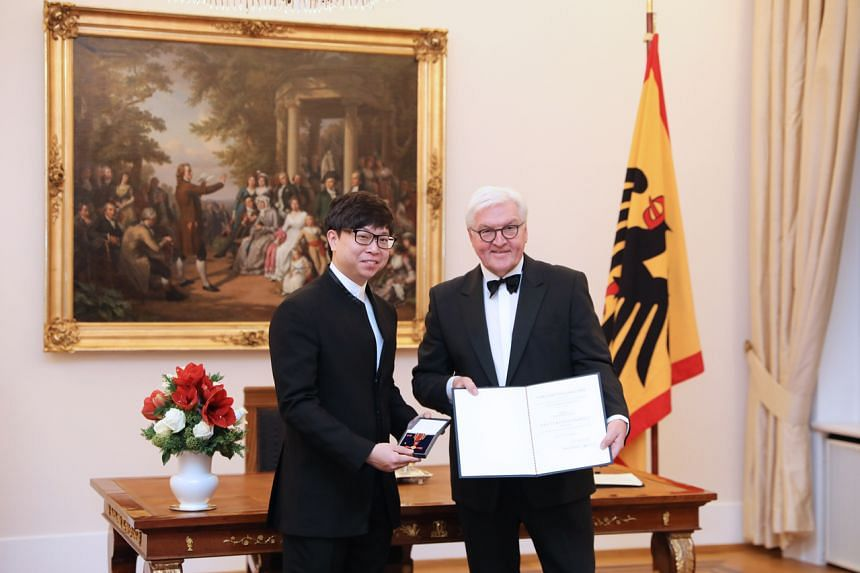 Singaporean conductor Wong Kah Chun (left) was conferred the Order of Merit of the Federal Republic of Germany by German President Frank-Walter Steinmeier on Dec 10, 2019.
