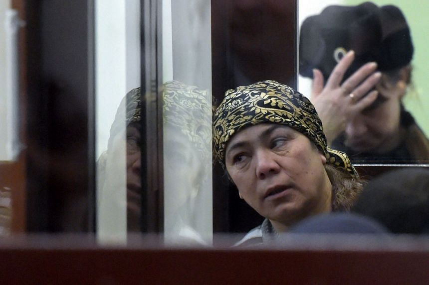 Shokhista Karimova, accused of involvement in the bombing, is seen inside a defendants' cage.