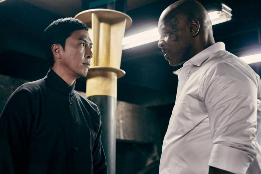 Boxer Mike Tyson (right) appeared in Ip Man 3 as a property developer with links to the triads.