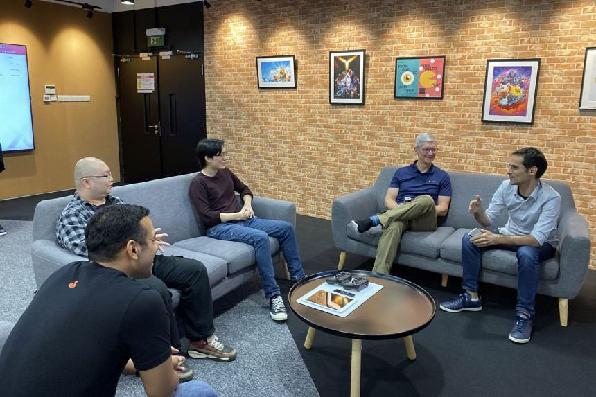 Apple chief executive office Tim Cook (centre right) visited Pixel Studios on Dec 11, where he met the founder of Tendays Studio, Wilfreed Trottet (right) and co-founder of The Gentlebros, Desmond Wong (centre left).