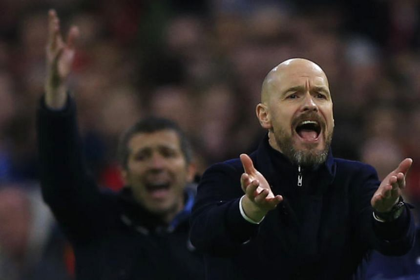 Ajax's head coach Erik ten Hag (right) and Valencia's head coach Albert Celades, gesture during the group H Champions League soccer match between Ajax and Valencia at the Johan Cruyff Arena in Amsterdam, on Dec 10, 2019.