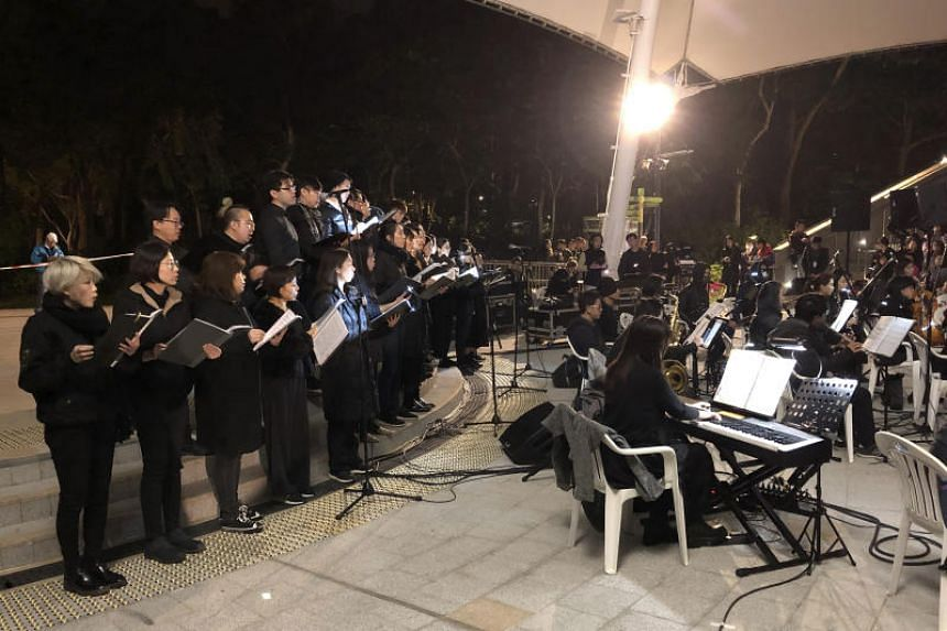 In a photo taken on Dec 10, 2019, a theatre troupe performs Les Miserables in at an outdoor event space in Hong Kong.