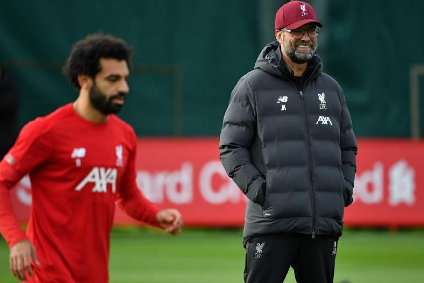 Liverpool manager Jurgen Klopp (right) praised player Mohamed Salah for showing self-belief after he spurned several straightforward chances before scoring during the Champions League match against Salzburg on Dec 10, 2019.