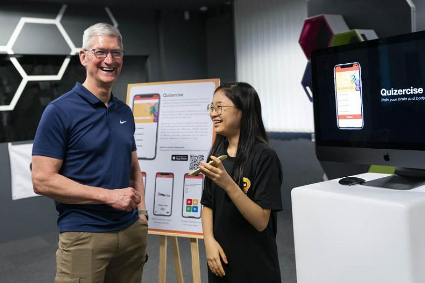 Apple chief executive officer Tim Cook, alongside Quizercise co-creator Faith Lim. Faith is one of the 100 graduates of Apple's Swift Accelerator coding programme.