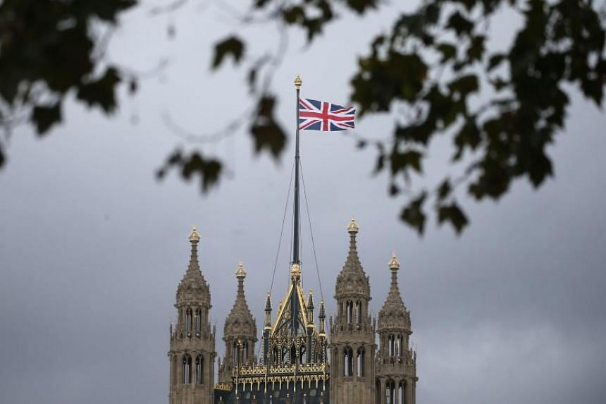 In a photo taken on Oct 29, 2019, a Union flag flies over the Houses of Parliament in central London.