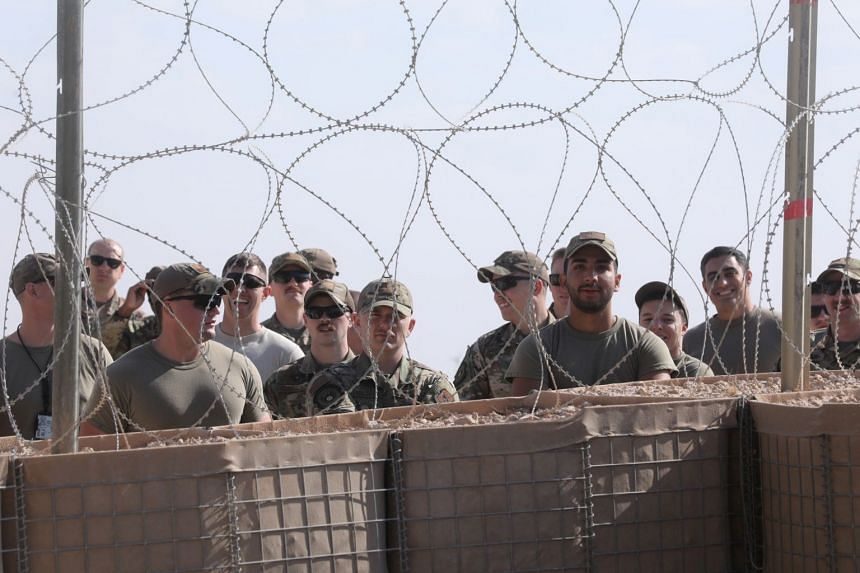 US soldiers gather as US Vice-President Mike Pence arrives for meetings at Al Asad Air Base, in Iraq, Nov 23, 2019.