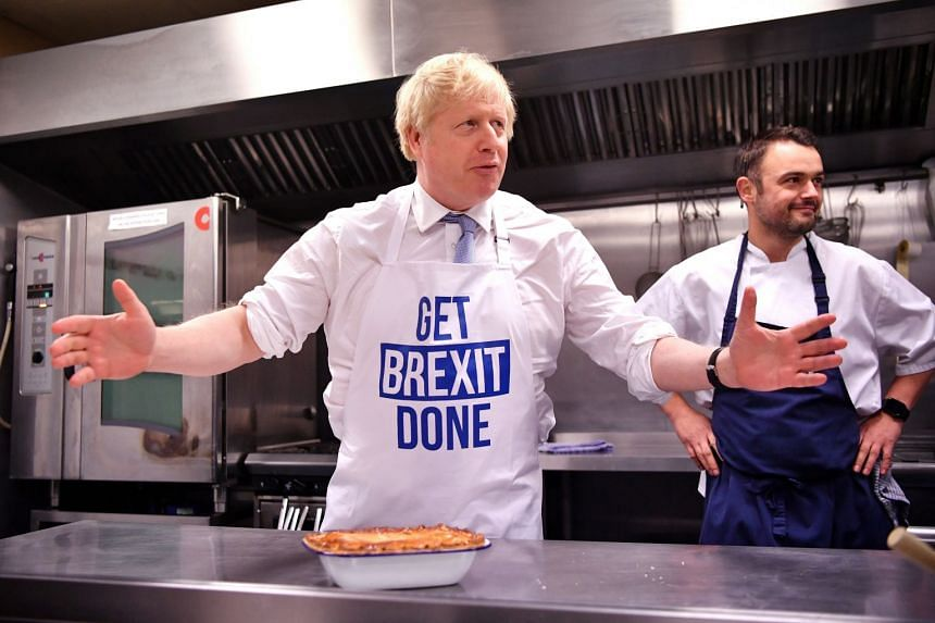 Johnson prepares a pie at the Red Olive kitchen in Derby, on the final day of campaigning.