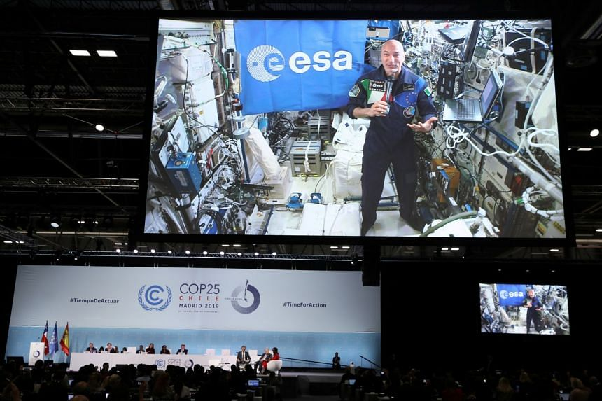 Parmitano speaks through an in-flight connection from space to panelists including UN Secretary-General Antonio Guterres and Spain's Sience Minister Pedro Duque.