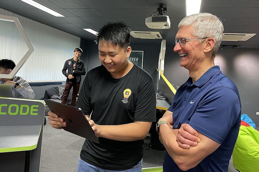 Apple chief executive Tim Cook with Sean Wong, 16, a Ngee Ann Secondary student who has completed Apple's Swift Accelerator programme.