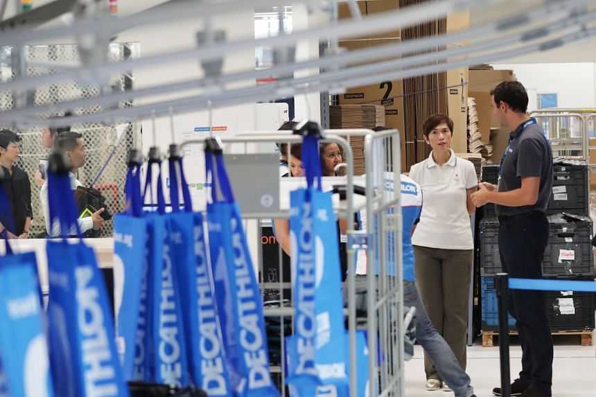 Manpower Minister Josephine Teo (in white) said that Decathlon, a French sporting goods retailer, has redefined jobs in the sector, where employees learn skills such as digital marketing, Web merchandising and improving customer experience.