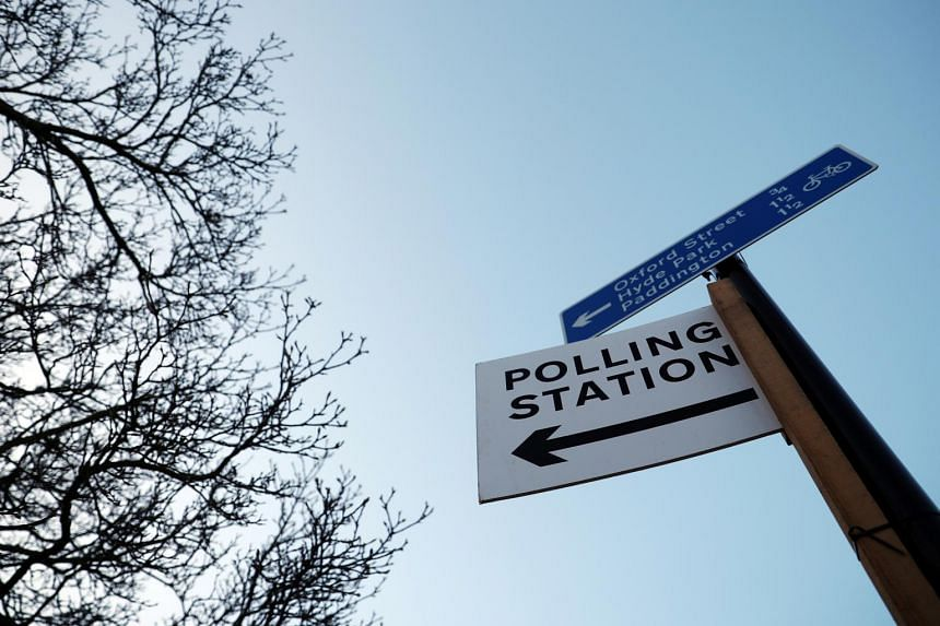 A polling station sign is seen in London, Britain, on Dec 11, 2019.