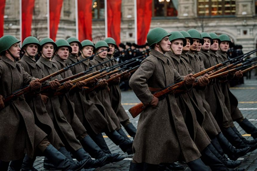 Russian servicemen dressed in historical uniforms march during the military parade at Red Square in Moscow, on Nov 7, 2019.