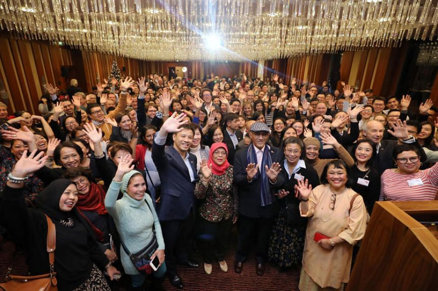 President Halimah Yacob (centre) met more than 200 Singaporeans living in Germany at the Jumeirah Hotel in Frankfurt on Dec 11, 2019. On her right is Singapore's ambassador to Germany Laurence Bay, while her husband Mohamed Abdullah Alhabshee is on h