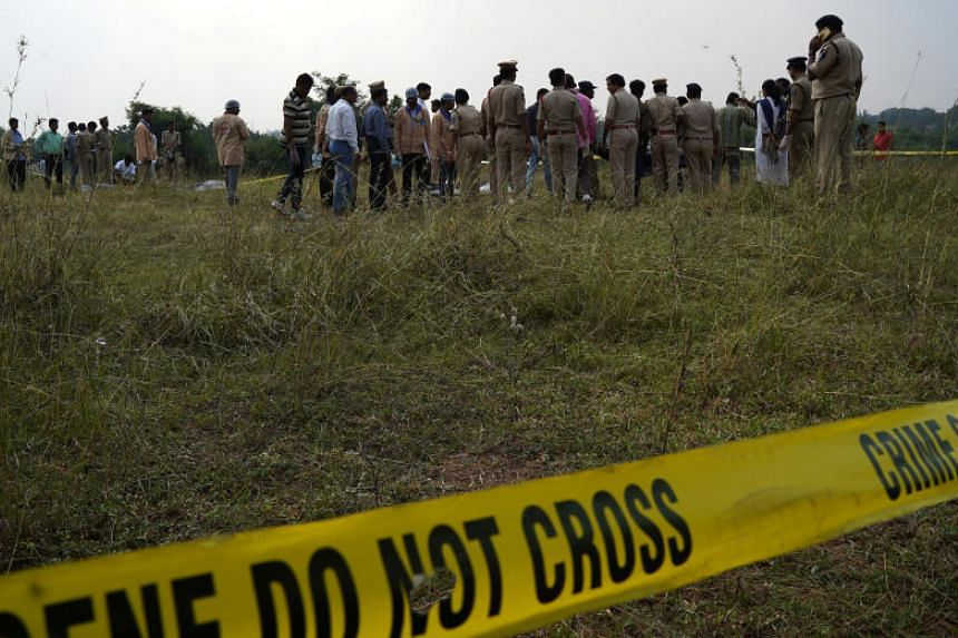 A photo taken on Dec 6, 2019, shows forensic officials at the site where police shot dead four men suspected of raping and killing a 27-year-old veterinarian, in Chatanpally, India.