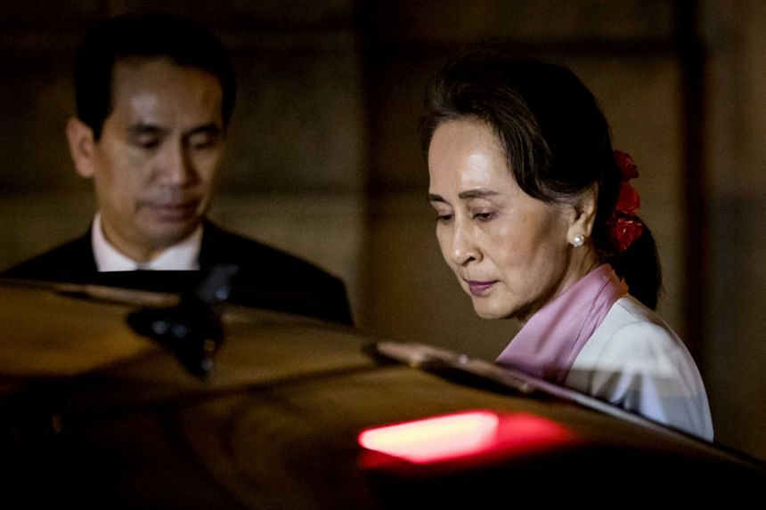 Myanmar's de facto civilian leader Aung San Suu Kyi departs the Peace Palace after the third day of hearings on the Rohingya genocide case in The Hague, the Netherlands, on Dec 12, 2019.