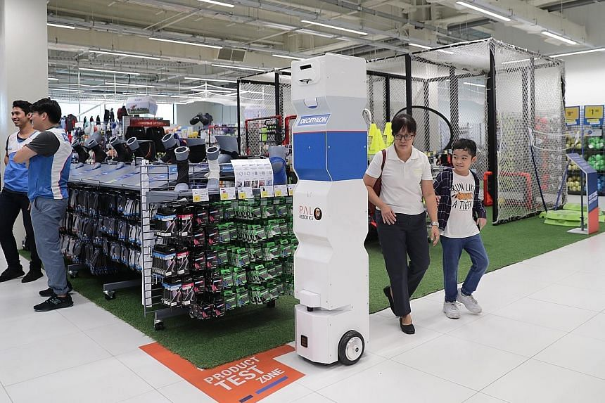 A demonstration of a robot deployed for stock inventory checking at the Decathlon Singapore Lab.