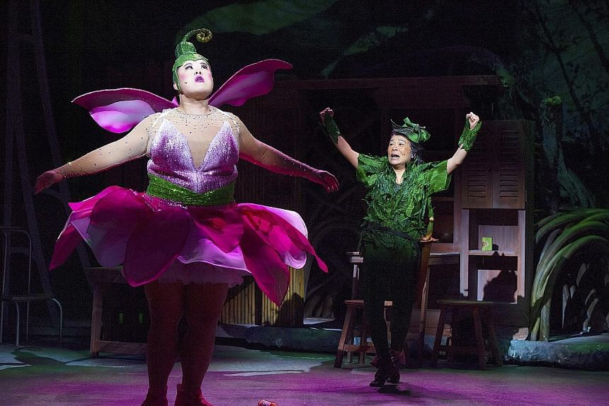 Pam Oei stars as Peter Pan (right) and Andrew Marko dons a tutu as the fairy Ting Tong Bell (left).