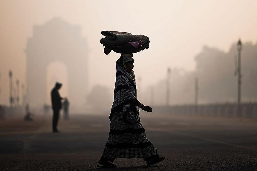 """New Delhi's 20 million residents have had """"moderate"""" to """"satisfactory"""" air only for four days in the past two months. PHOTO: AGENCE FRANCE-PRESSE"""