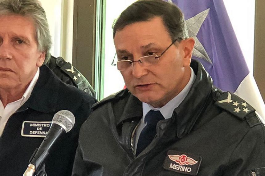 General Arturo Merino (right) speaks during a press conference at the Chabunco Military base in Punta Arenas, Chile.