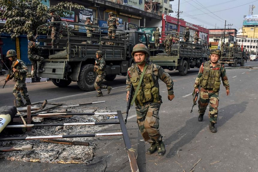 Indian soldiers patrolling during a curfew following protests over the government's Citizenship Amendment Bill in Guwahati on Dec 12, 2019.