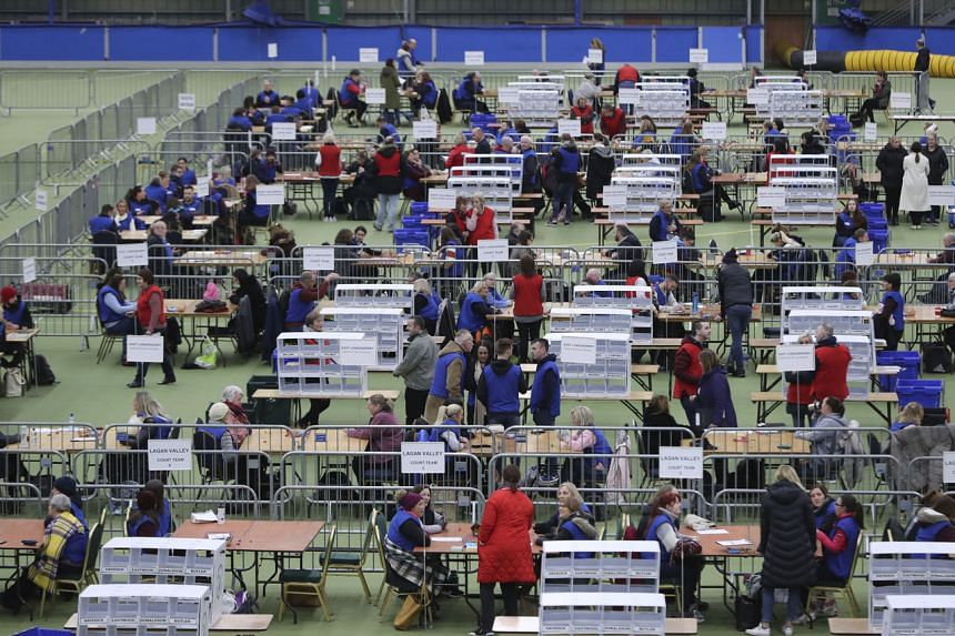 Counting teams prepare to count ballots at the Meadowbank Sports Arena in Northern Ireland.