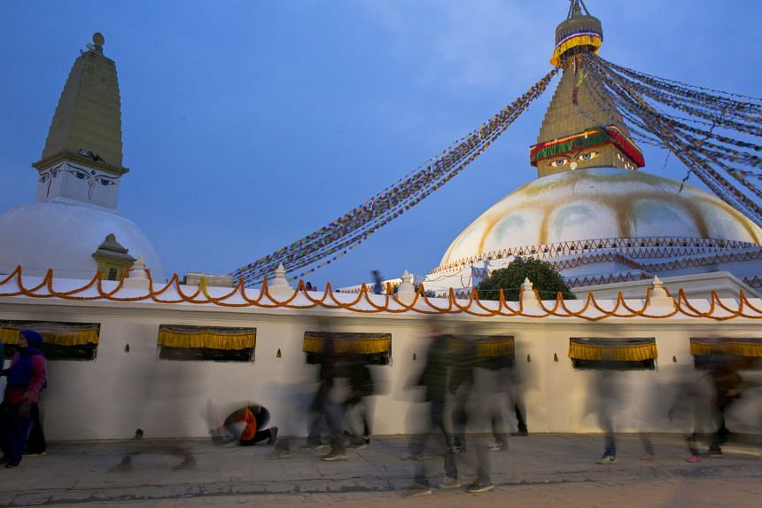 People walking past the Boudhanath Stupa in Kathmandu, Nepal, on Dec 12, 2019.
