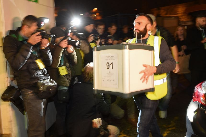 Ballot boxes being carried into a hall at a count centre in Uxbridge, London.
