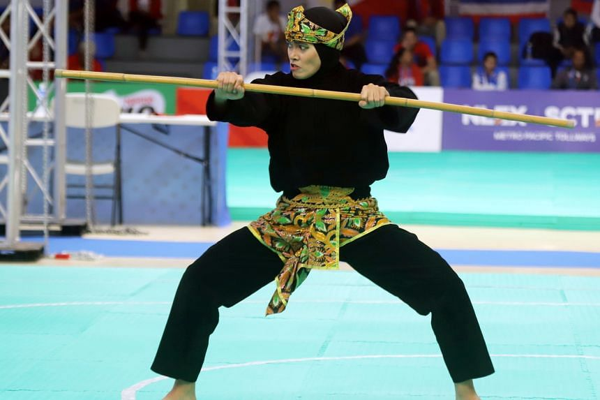 In a photo taken on Dec 3, 2019, Indonesia's Puspa Arum Sari performs during the women's seni tunggal competition of the pencak silat events at the SEA Games in Subic freeport, the Philippines.