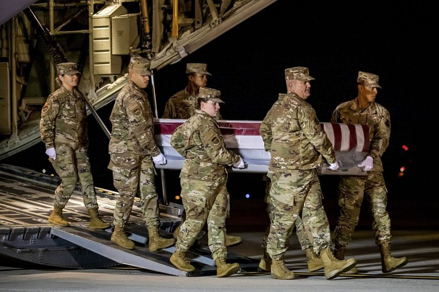 The remains of Ensign Joshua Kaleb Watson, one of the people killed in the attack, are transferred at Dover Air Force Base in Delaware, US.