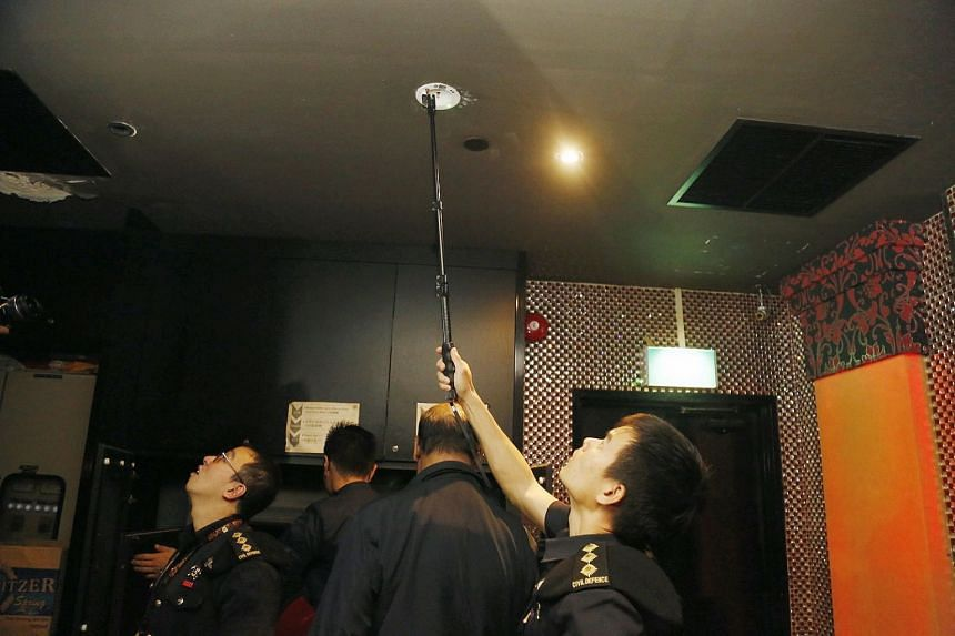An inspection of the serviceability of an emergency light. In the event of power failure during an emergency, these lights must be lit to provide illumination for the safety of those evacuating.