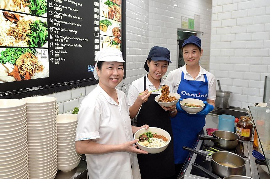 Xuan Miao Vegan's employees with bowls of ban mian at the Paya Lebar Square outlet.