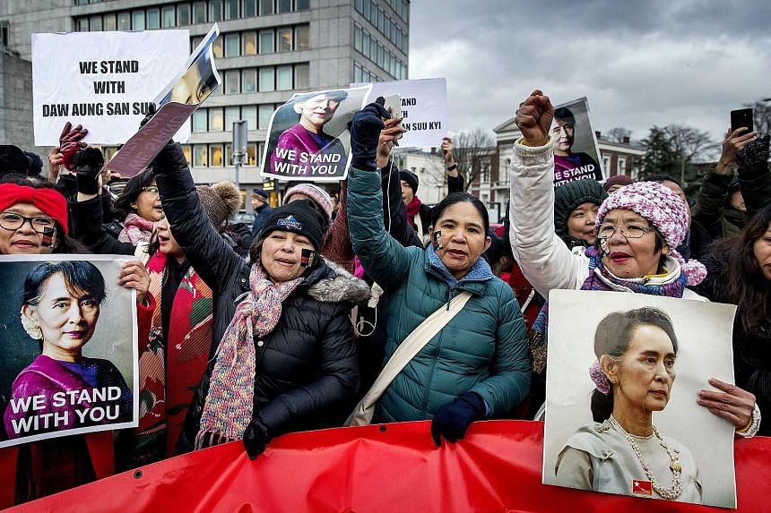 Supporters of Myanmar's leader Aung San Suu Kyi in front of the Peace Palace in The Hague during hearings this week on the Rohingya genocide case. Ms Suu Kyi was defending her country at the International Court of Justice against accusations of genoc