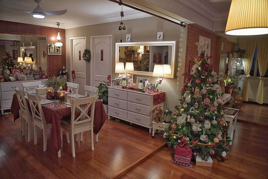 Ms Veronica Chan plans her family's Christmas display way ahead of time, sometimes making her own ornaments, such as adding beads to baubles, but on the day of the decorating, her whole family chips in.