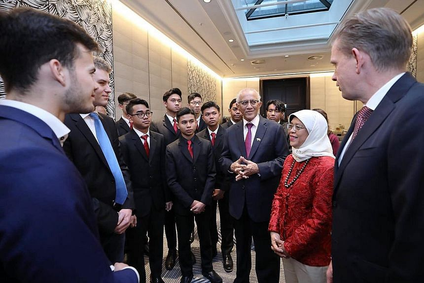President Halimah Yacob and her husband, Mr Mohamed Abdullah Alhabshee, meeting ITE students from Singapore in Frankfurt yesterday. The students were on a two-week attachment to German electronics firm Rohde & Schwarz. PHOTO: MCI