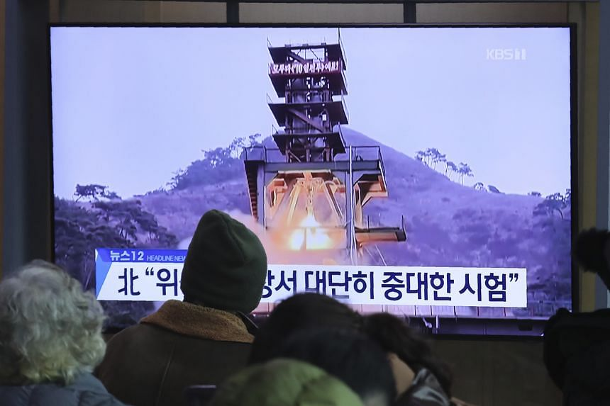In a photo from Dec 9, 2019, a TV screen shows a file image of a ground test of North Korea's rocket engine during a news programme at the Seoul Railway Station in Seoul, South Korea.