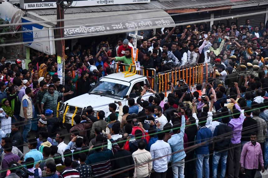 People gather as the body of Sam Stafford, who was killed after police fired during a protest against the government's Citizenship Amendment Bill a day before, is carried on a vehicle for cremation, in Guwahati, India, on Dec 13, 2019.