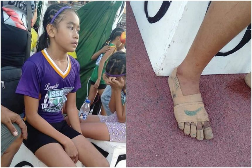 """Rhea Bullos bagged three gold medals at an athletics competition without wearing shoes, opting instead to wrap her feet in tape and draw an iconic Nike """"swoosh"""" logo on them."""