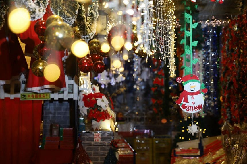 Visitors are greeted with baubles and fairy lights upon entering the store.