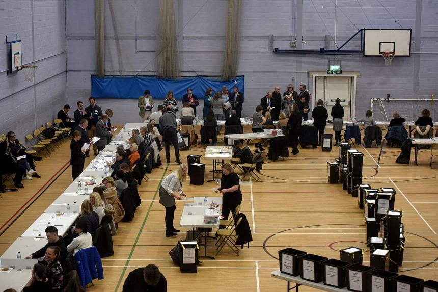 Volunteers count votes in Clowne, England, on Dec 12, 2019. Labour suffered its worst election showing since 1935.