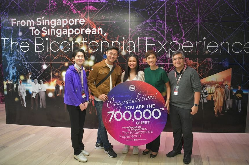 Manpower Minister Josephine Teo (second from right) with the Bicentennial's 700,000th visitor, Mr Roger Lim, as well as his girlfriend Ms Michelle Liew (second and third from left) on Dec 14, 2019.