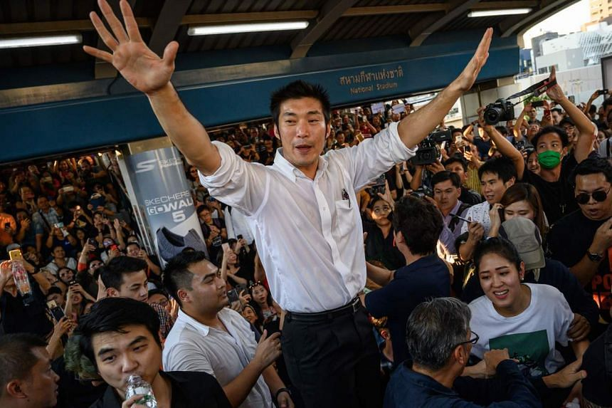 Thai Future Forward Party leader Thanathorn Juangroongruangkit addressess his supporters during an unauthorized flash mob rally in downtown Bangkok on Dec 14, 2019.