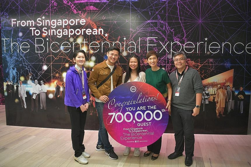 (From left) Mr Gene Tan, executive director of the Singapore Bicentennial Office; Mr Roger Lim, the Bicentennial Experience's 700,000th visitor, and his girlfriend Michelle Liew; Manpower Minister Josephine Teo, who is also co-chairman of the ministe