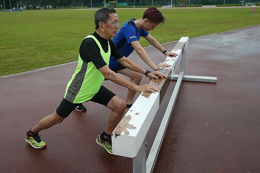 Kor Hong Fatt and grandson Aston Kor cooling down after a run. The older Kor, who suffered a heart attack 17 years ago, took up running seriously and has not looked back.